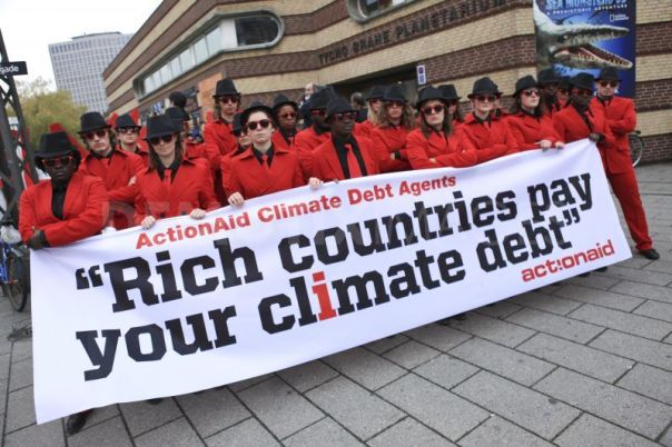Demonstrators at COP15 Copenhagen which marked the start of the long slow death of the UN Climate process which will be laid to rest at COP20, Paris in 2015.