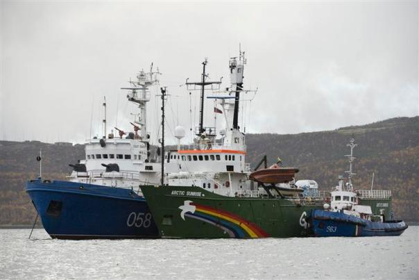 The Greenpeace ship Arctic Sunrise anchored near Murmansk with a Russian Coastguard  gunboat and tug.